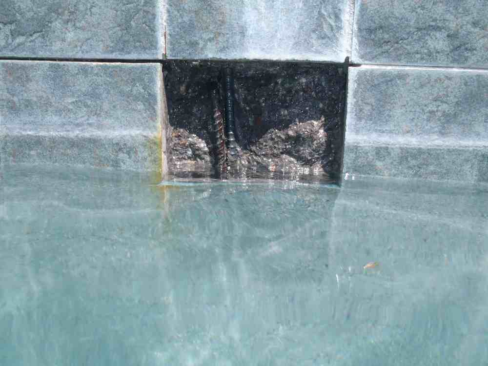 Rebar Rust Stain Behind Waterline Tile Underwater Operations